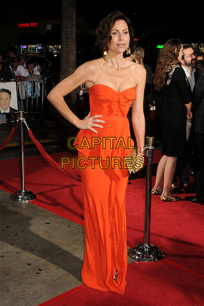 """MINNIE DRIVER .AFI Fest 2010 Screening of """"Barney's Version"""" held at The Egyptian Theatre, Hollywood, California, USA, .6th November 2010..full length strapless orange dress long maxi hand on hip buttons peplum gold clutch bag  .CAP/ADM/BP.©Byron Purvis/AdMedia/Capital Pictures."""