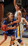 SIOUX FALLS, SD - MARCH 11:  Amanda Hyde #11 from IPFW looks for room past Megan Waytashek #24 from South Dakota State in the first half of their semifinal game Monday afternoon at the 2013 Summit League Tournament in Sioux Falls, SD.  (Photo by Dave Eggen/Inertia)