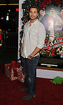 "HOLLYWOOD, CA - NOVEMBER 02: Eric Winter arrives at the ""A Very Harold & Kumar 3D Christmas"" Los Angeles Premiere at Grauman's Chinese Theatre on November 2, 2011 in Hollywood, California."