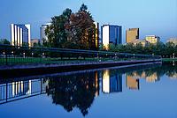 Downtown Bellevue's skyline mirrored in a reflecting pool at dusk in Bellevue Downtown Park. Bellevue, WA.