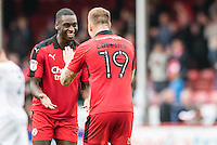 Both goal scorers Enzio Boldewijn of Crawley Town (7) (left) and James Collins of Crawley Town (19) (right) celebrate victory   during the Sky Bet League 2 match between Crawley Town and Luton Town at the Broadfield/Checkatrade.com Stadium, Crawley, England on 17 September 2016. Photo by Edward Thomas / PRiME Media Images.