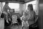 Appleby in Westmorland traditional annual gypsy Horse Fair Cumbria. 1981. Grandmother and baby granddaughter, interior of caravan with TV set.