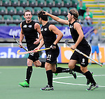 The Hague, Netherlands, June 15: Kane Russell #21 of New Zealand is congratulated by teammates after scoring a penalty corner for a 0-1 lead during the field hockey placement match (Men - Place 7th/8th) between Spain and the Black Sticks of New Zealand on June 15, 2014 during the World Cup 2014 at Kyocera Stadium in The Hague, Netherlands.  Final score after full time 1-1 (0-1). The Black Sticks of New Zealand win the shoot-out 1-4.  (Photo by Dirk Markgraf / www.265-images.com) *** Local caption ***