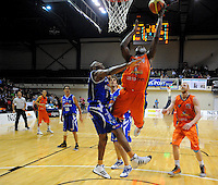 Sharks import Sylvester Spicer lays a shot up past Erron Maxey. NBL - Wellington Saints v Southland Sharks at TSB Bank Arena, Wellington, New Zealand on Friday, 22 April 2011. Photo: Dave Lintott / lintottphoto.co.nz