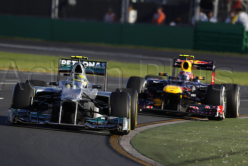 18.03.2012. Melbourne, Australia.   FIA Formula One World Championship 2012 Grand Prix of Australia 8 Nico Rosberg ger Mercedes AMG Petronas F1 team and Mark Webber AUs Red Bull Racing Jenson Button won the race with Sebbastian Vettel in second and Lewis Hamilton in third place.