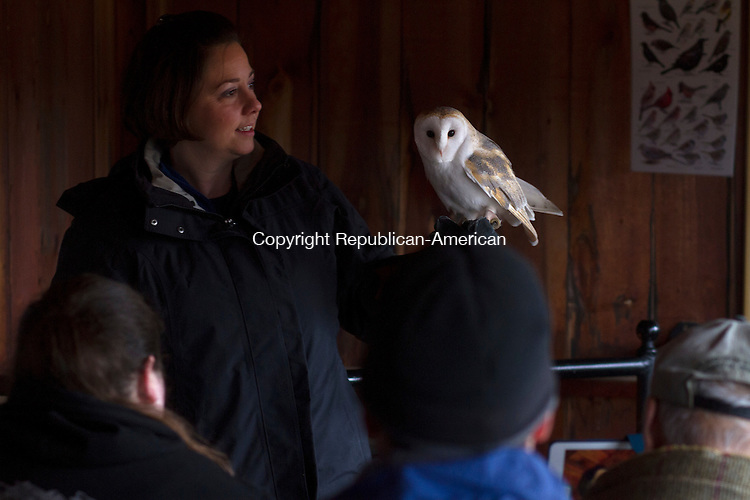 WATERTOWN, CT - 16 JANUARY 2016 - 011616JW06.jpg -- Connecticut Audobon Society Education Manager Tricia Kevalis shows one of the society's owls to a group viewing the Bald Eagles at the Shepaug Hydroelectric Station Saturday morning.   Jonathan Wilcox Republican-American