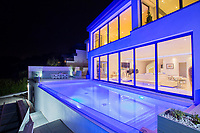 BNPS.co.uk (01202 558833)<br /> Pic: KnightFrank/BNPS<br /> <br /> Mood lighting for when the sun goes down...<br /> <br /> Yours for 3 million pounds - Mediterranean style views...from a seaside home in Torquay.<br /> <br /> This modern and contemporary property is in one of the most exclusive areas of Torquay in Devon and has spectacular views of Tor Bay.<br /> <br /> In the foreground in the rocky outcrop known as Thatcher's Rock.<br /> <br /> But the coastal landmark isn't named after the late Tory Prime Minister but the fact that from certain angles the rock formation looks like a thatcher working on a roof.