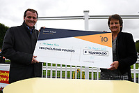 Trainer Richard Hannon receives a cheque from sponsors after winning the M J Church British EBF Novice Stakes (Plus 10) (Div 2),  during Afternoon Racing at Salisbury Racecourse on 7th August 2017