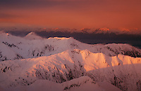 Aerial photographs of South Chilkat Mountains with snow blowing near sunset in Southeast Alaska.