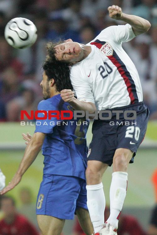 FIFA WM 2006 -  Gruppe E Vorrunde ( Group E )<br /> Play   #25 (17-Jun) - Italien - USA<br /> <br /> Brian Mc Bride (rechts) von USA im Kopfball Duell mit Gennaro Gattuso (links) von Italien.<br /> <br /> Foto &copy; nordphoto