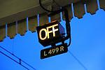 OFF electric light sign on railway platform, England, UK