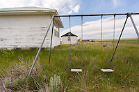 Old swingset behind an abandoned school in Boyes, MT
