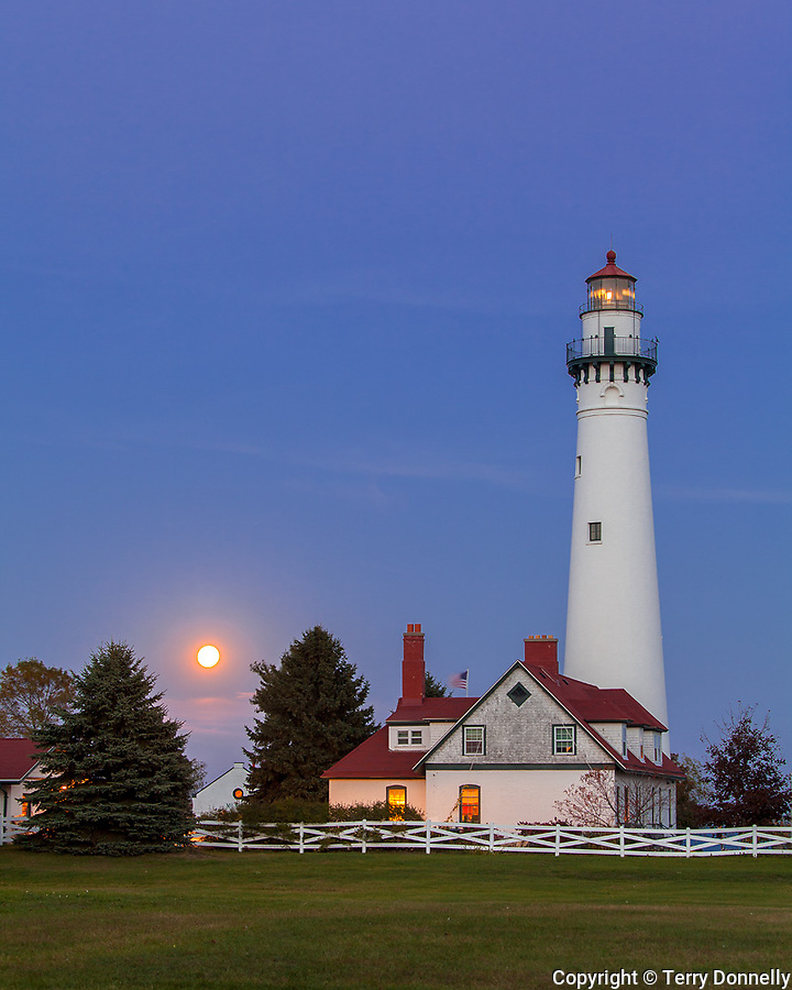 Racine County, Wisconsin<br /> Wind Point Lighthouse (1880) with moonrise at dusk, Lake Michigan