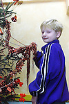Marick Tomi pictured decorating the tree in Mosney..Pic Newsfile