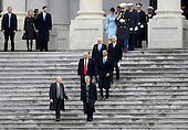 United States President Donald Trump and former US President Barack Obama walks on the steps of the Capitol in Washington, Friday, Jan. 20, 2017, with Vice President Mike Pence and former Vice President Joe Biden along with with first lady Melania Trump and Michelle Obama, prior to the Obama's departure to Andrews Air Force Base, Md., following the presidential inauguration.<br /> Credit: Rob Carr / Pool via CNP