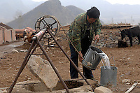 A farmer gets water for his horse from a well in Hubei Province, China. Much of the north is undergoing water shortages..30 Mar 2008