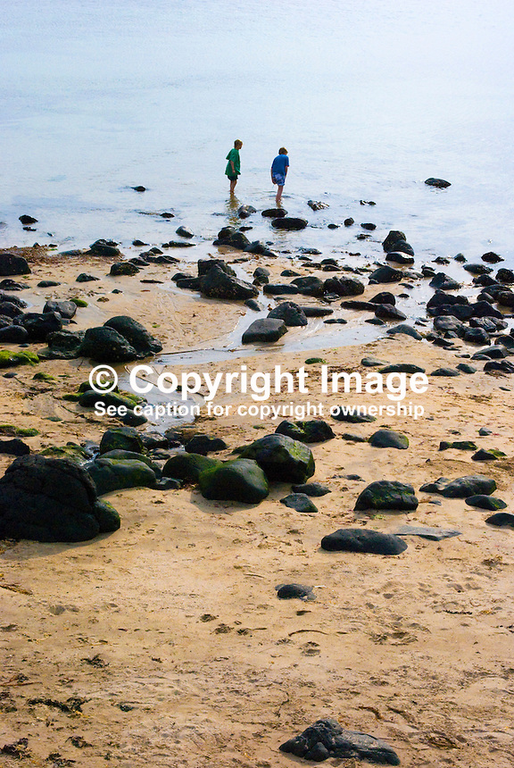 Beach, rocks, sea, paddlers, sand, young, boys, Portstewart, Co Londonderry, N Ireland, UK, 200906292773..Copyright Image from Victor Patterson, 54 Dorchester Park, Belfast, UK, BT9 6RJ..Tel: +44 28 9066 1296.Mob: +44 7802 353836.Voicemail +44 20 8816 7153.Skype: victorpattersonbelfast.Email: victorpatterson@mac.com.Email: victorpatterson@ireland.com (back-up)..IMPORTANT: If you wish to use this image or any other of my images please go to www.victorpatterson.com and click on the Terms & Conditions. Then contact me by email or phone with the reference number(s) of the image(s) concerned.