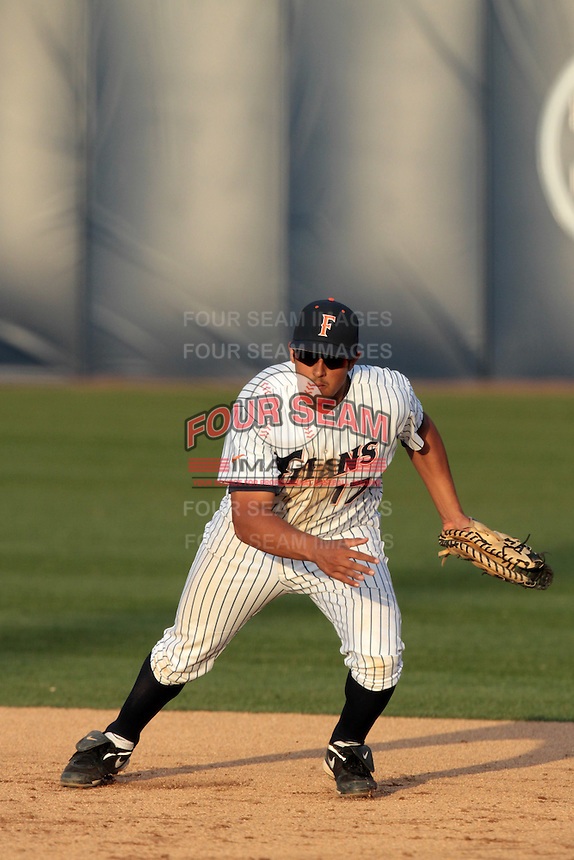 Carlos Lopez #17 of the Cal State Fullerton Titans in the field against the Loyola Marymount Lions at Goodwin Field on February 29, 2012 in Fullerton,California. Cal State Fullerton defeated LMU 6-2.(Larry Goren/Four Seam Images)