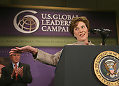 Washington, D.C. - May 31, 2007 -- First lady Laura Bush acknowledges applause before introducing United States President George W. Bush for remarks on the United States International Development Agenda at the Ronald Reagan Building and International Trade Center in Washington, D.C. on Thursday, May 31, 2007.<br /> Credit: Dennis Brack - Pool via CNP