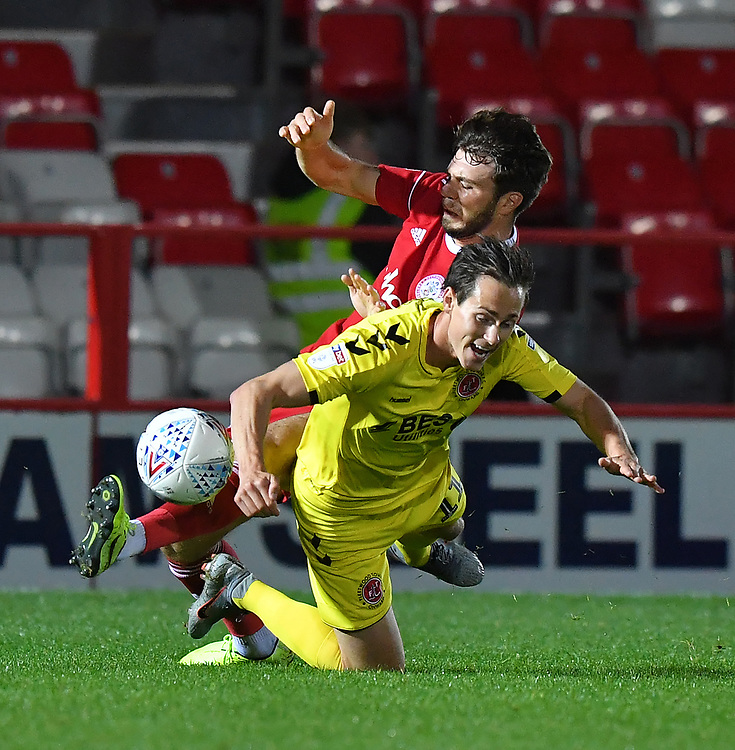 Fleetwood Town's Josh Morris battles with Accrington Stanley's Joe Maguire<br /> <br /> Photographer Dave Howarth/CameraSport<br /> <br /> EFL Leasing.com Trophy - Northern Section - Group B - Tuesday 3rd September 2019 - Accrington Stanley v Fleetwood Town - Crown Ground - Accrington<br />  <br /> World Copyright © 2019 CameraSport. All rights reserved. 43 Linden Ave. Countesthorpe. Leicester. England. LE8 5PG - Tel: +44 (0) 116 277 4147 - admin@camerasport.com - www.camerasport.com