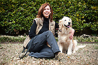 Susannah Charleson (cq) and her dog Puzzle (cq) pose for a portrait in Dallas, Texas, US, Friday, March 19, 2010. Charleson, who works with Puzzle as a search and rescue team will be releasing her book Scent of the Missing: Love and Partnership with a Search and Rescue dog on April 14. ..Photo/ MATT NAGER