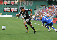 Jaime Moreno #99  of D.C. United breaks away from Dennis Alas #14  of El Salvador during an international charity match at RFK Stadium, on June 19 2010 in Washington DC. D.C. United won 1-0.
