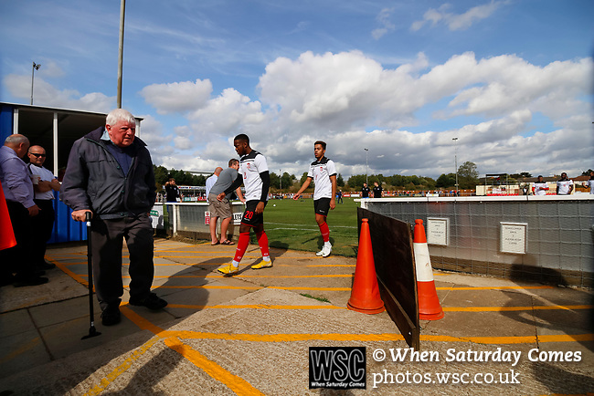 Kettering players return to the dressing room after warming up. Kettering Town 1 Leiston 2, Evo Stick Southern League Premier Central, Latimer Park. Kettering Town are a famous name in non-league football. After financial problems, relegations, and relocation, the club are once again upwardly mobile. Despite losing to Leiston, Kettering finished the season as Champions and were promoted to the National League North.