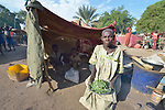 Araj Madut shows some wild leaves she has harvested to feed her family in a camp for over 5,000 internally displaced persons in an Episcopal Church compound in Wau, South Sudan. Most of the families here were displaced by violence early in 2017, after a larger number took refuge in other church sites when widespread armed conflict engulfed Wau in June 2016.<br /> <br /> The leaves are a common &quot;hunger food,&quot; eaten by people when no other food is available. Conflict, climate change and corruption have contributed to widespread hunger in South Sudan, and many living in this camp will be unable to leave to cultivate their fields this year.<br /> <br /> Norwegian Church Aid, a member of the ACT Alliance, has provided relief supplies to the displaced in Wau, and has supported the South Sudan Council of Churches as it has struggled to mediate the conflict in Wau.