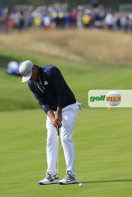 Brooks Koepka Team USA putts to win the match on the 18th green during Friday's Fourball Matches at the 2018 Ryder Cup, Le Golf National, Iles-de-France, France. 28/09/2018.<br /> Picture Eoin Clarke / Golffile.ie<br /> <br /> All photo usage must carry mandatory copyright credit (© Golffile | Eoin Clarke)