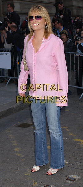 GABY ROSLIN.At the opening of The Saatchi Gallery, County Hall, London..15th April 2003.full length, full-length, denim, jeans, sunglasses, shades, pink shirt.www.capitalpictures.com.sales@capitalpictures.com.Supplied By Capital PIctures