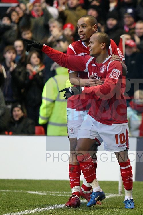 Nottingham Forest's Robert Earnshaw celebrates the opening goal with Radoslaw Majewski
