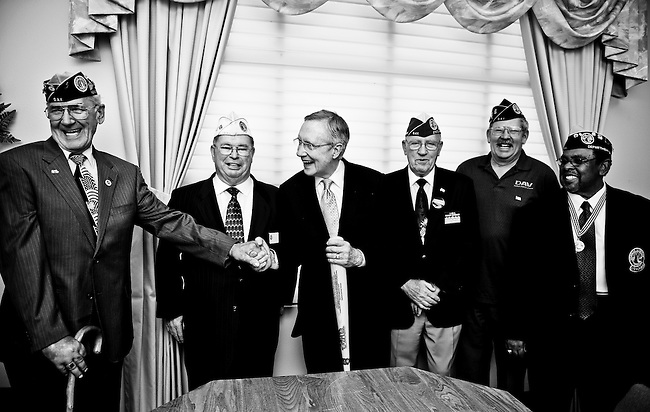 Senate Majority Leader Harry Reid, D-Nev., center, is presented with an engraved bat from the Disabled American Veterans following the Memorial Day ceremony at the Southern Nevada Veterans Memorial Cemetery in Boulder City, Nev., on May 31, 2010.