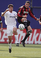 The EarthQuakes' Brian Ching and Mark Lisi of the MetroStars battle for the ball during first half action between the MetroStars and the San Jose EarthQuakes at Giant's Stadium, East Rutherford, NJ, on Saturday May 7, 2005.