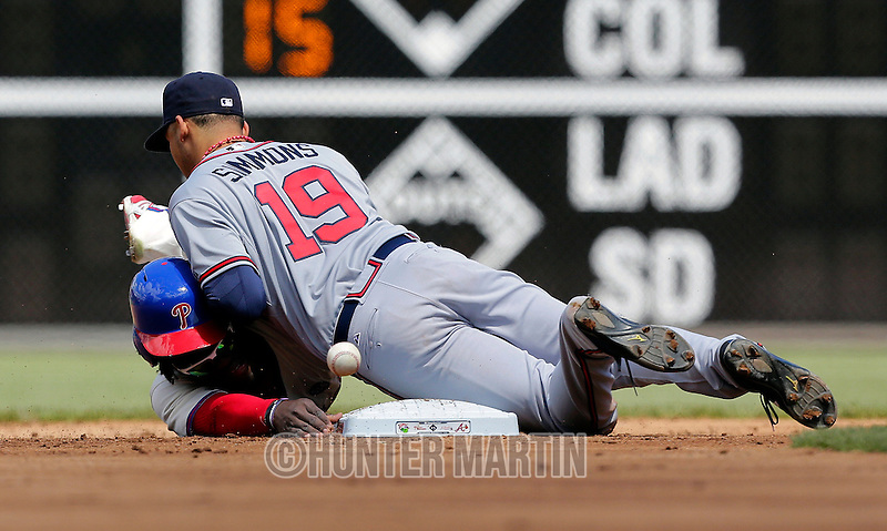 PHILADELPHIA - APRIL 26: Odubel Herrera #37 of the Philadelphia Phillies is ruled safe at second base as Andrelton Simmons #19 of the Atlanta Braves drops the ball in the first inning during a game at Citizens Bank Park on April 26, 2015 in Philadelphia, Pennsylvania. (Photo by Hunter Martin/Getty Images) *** Local Caption *** Odubel Herrera;Andrelton Simmons