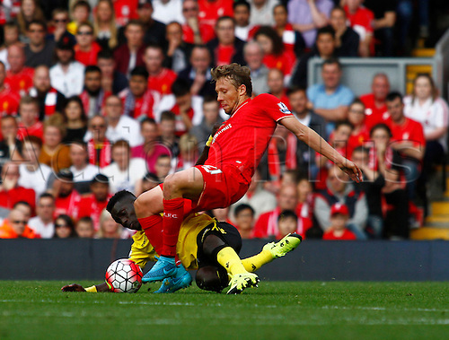 26.09.2015. Liverpool, England. Barclays Premier League. Liverpool versus Aston Villa. Liverpool's Lucas Leiva is brought down by Aston Villa's Idrissa Gueye.