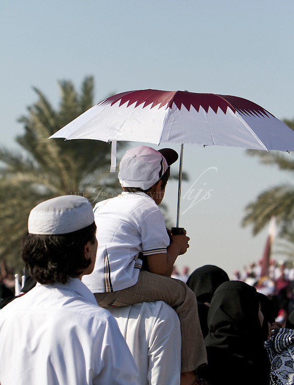 Qatari Family watching the parade on their National Day. Doha, Qatar | Dec 10