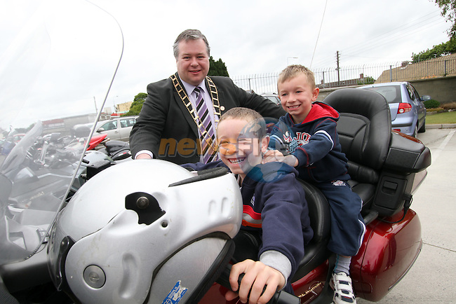 "Mayor Paul Bell with Evan and Leonard before the ""Run of the Country"" Motorcycle fundraiser at St.Itas school...(Photo credit should read Jenny Matthews www.newsfile.ie)....This Picture has been sent you under the conditions enclosed by:.Newsfile Ltd..The Studio,.Millmount Abbey,.Drogheda,.Co Meath..Ireland..Tel: +353(0)41-9871240.Fax: +353(0)41-9871260.GSM: +353(0)86-2500958.email: pictures@newsfile.ie.www.newsfile.ie."