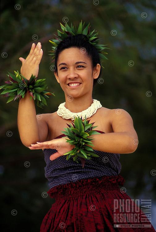 Young woman making a niu ( palm tree ) as a hula gesture