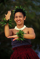Young woman making a niu ( palm tree ) as a hula gesture