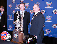 31 December 2009: Florida head coach Urban Meyer and Cincinnati interim head coach Jeff Quinn pose together for photo shoot during Sugar Bowl Press Conference at the Marriott Hotel in New Orleans, Louisiana.