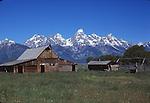 historic log barn and Grand Tetons