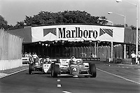 MIAMI, FL - NOVEMBER 9: Danny Sullivan drives his March 85C 37/Cosworth en route to victory in the Beatrice Indy Challenge CART IndyCar race on the temporary street circuit in Tamiami Park in Miami, Florida, on November 9, 1985.