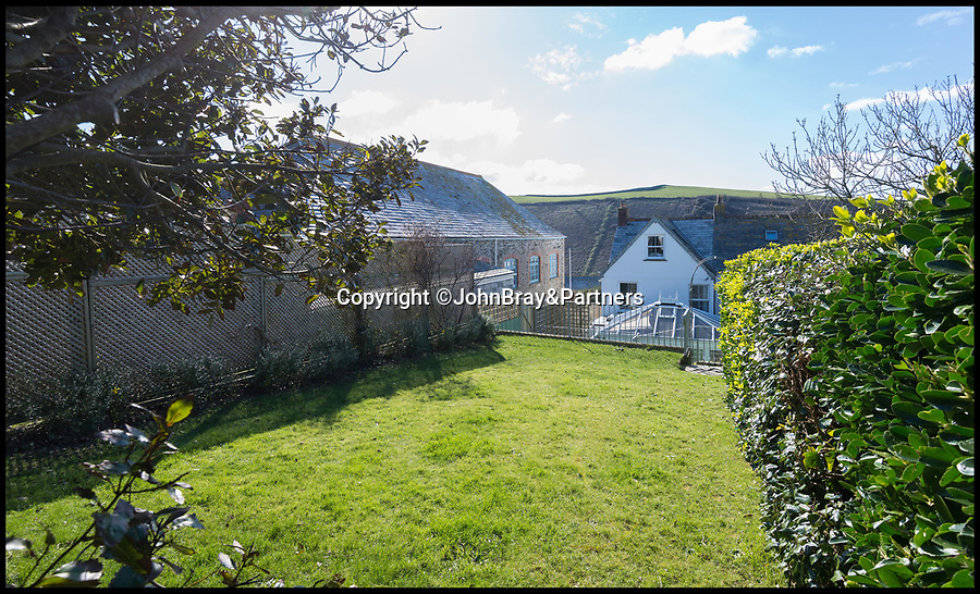 BNPS.co.uk (01202 558833)<br /> Pic: JohnBray&Partners/BNPS<br /> <br /> Doc Martin fans will be fighting to get their hands on this Cornish holiday cottage in the hugely sought-after fishing village - on the market for £560,000.<br /> <br /> Harewood, a three-bedroom Victorian home, is set back from the picturesque harbour of Port Isaac in a prime hill-side spot where the owners can look out over not only the harbour, where a lot of filming takes place, but also across to Doc Martin's 'surgery', Fern Cottage.<br /> <br /> The lucky homebuyers could buy themselves a front row seat to the action, with the ninth and final series of the ITV comedy drama set to start filming in spring next year.<br /> <br /> Doc Martin has been filmed in Port Isaac since 2004, when it started doubling as the fictional village of Port Wenn.