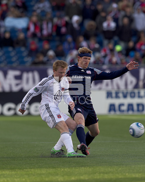 DC United midfielder Dax McCarty (10) passes the ball as New England Revolution midfielder Pat Phelan (28) defends. In a Major League Soccer (MLS) match, the New England Revolution defeated DC United, 2-1, at Gillette Stadium on March 26, 2011.