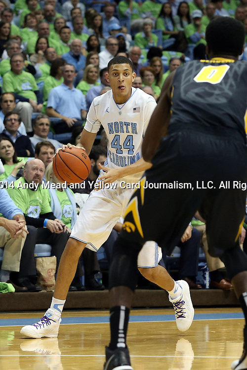 03 December 2014: North Carolina's Justin Jackson (44) and Iowa's Gabriel Olaseni (ENG) (0). The University of North Carolina Tar Heels played the University of Iowa Hawkeyes in an NCAA Division I Men's basketball game at the Dean E. Smith Center in Chapel Hill, North Carolina. Iowa won the game 60-55.