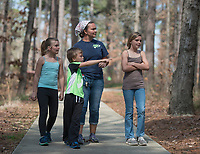 NWA Democrat-Gazette/ANTHONY REYES @NWATONYR<br /> Sherine Raines (center) of Pea Ridge looks off the Ozark Plateau Trail with her children (from left) Raelynn, 9, Ramsey, 6, Rylee, 10, Tuesday March 21, 2017 at Hobbs State Park in Rogers. The family was at the park to enjoy the nice weather and learn a little about the park and nature. The park has several spring break activities planned through the week including scavenger hunts and nature hikes. Contact the visitors center (479) 789-5000 for more information.