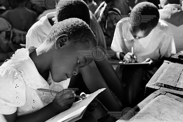Children go to school at a day-care centre for orphans in Lilongwe, Malawi on March 15, 2001. More than 13 million African children have been orphaned by the the AIDS pandemic. Worldwide, more than 20 million people have died since the first cases of AIDS were identified in 1981.