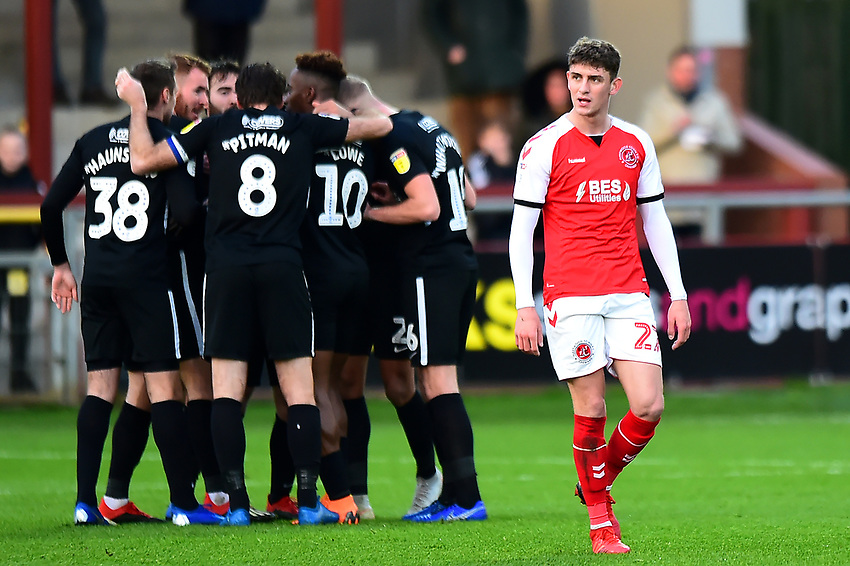 Fleetwood Town's Harrison Biggins looks on as Portsmouth celebrate their first goal<br /> <br /> Photographer Richard Martin-Roberts/CameraSport<br /> <br /> The EFL Sky Bet League One - Fleetwood Town v Portsmouth - Saturday 29th December 2018 - Highbury Stadium - Fleetwood<br /> <br /> World Copyright © 2018 CameraSport. All rights reserved. 43 Linden Ave. Countesthorpe. Leicester. England. LE8 5PG - Tel: +44 (0) 116 277 4147 - admin@camerasport.com - www.camerasport.com
