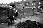 South Kirkby, Yorkshire. 1979<br /> A free coal delivery, tipped at the &lsquo;back entry&rsquo;, each household that burnt solid fuel received one ton of loose load delivery every month. <br /> Left for householders to transport it into their own coalhouse. This gave rise to the local youths making a bob or two for themselves by barrowing the coal into storage areas for a couple of shillings.  Pit Houses, as they were always known were built in the 1900&rsquo;s by the pit owners and later taken over by the National Coal Board. The coalhouse at the bottom of the garden contained an outside toilet and by the 1970&rsquo;s were converted by turning the toilet-coal house block into a bathroom with an extension for a new coal house.<br /> <br /> <br />  IF YOU KNOW THE NAMES OF ANY OF THESE PEOPLE I WOULD LIKE TO BE ABLE TOP PUT A NAME TO A FACE