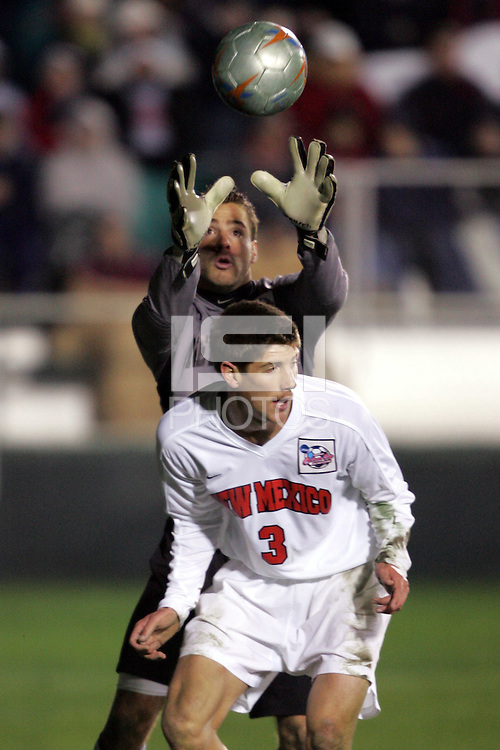 New Mexico's Andrew Boyens (3) ducks to allow his goalkeeper Mike Graczyk (behind) to play the ball in the penalty area. The University of New Mexico defeated Clemson University 2-1 in the NCAA Semifinal at SAS Stadium in Cary, North Carolina, Friday, December 9, 2005.